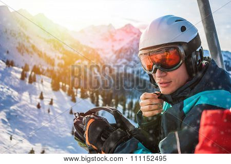 Young skier sitting in cabin on ski resort. Alps, Austria