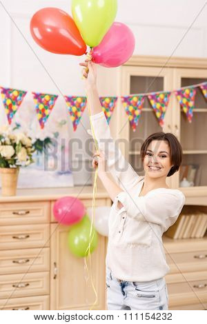 Young girl with colorful balloons