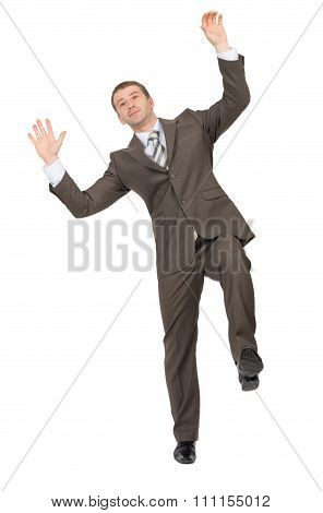 Businessman standing on one leg