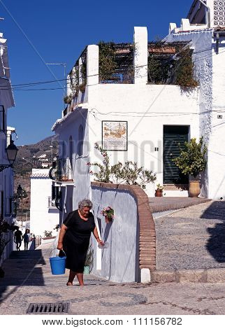 Spanish woman in street, Frigiliana.