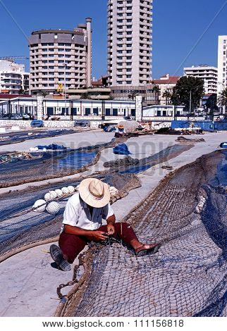 Fisherman mending nets, Fuengirola.