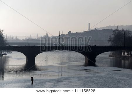 Manes Bridge In Prague A Foggy Morning And A Man