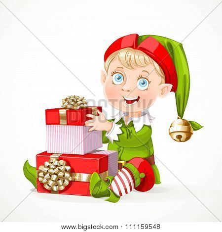 Cute Little Santa`s Elf Sit And Puts Boxes With Gifts  Isolated On A White Background