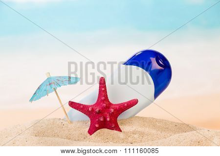 Sunscreen and red starfish on the sea