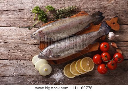 Raw Rainbow Trout With Ingredients On A Table. Horizontal Top View