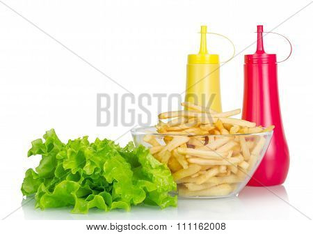 Lettuce, mustard, ketchup with fries isolated on white backgroun