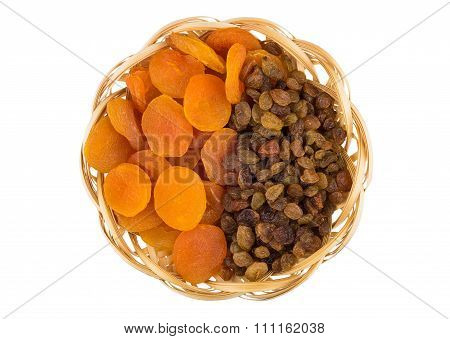 Dried Apricots And Raisins In Wicker Basket Isolated On White