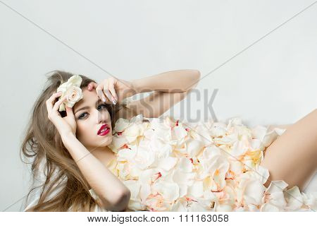 Young Woman In Flower Petals
