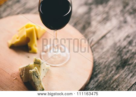 Cheese And Glass Of  Red Wine On Salver