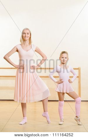 Ballet teacher and her apprentice are busy dancing.