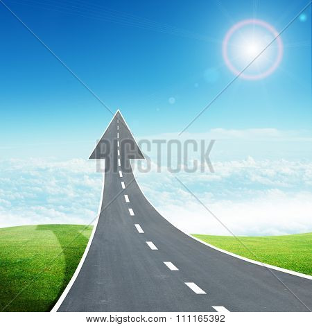 Freeway road going up as an arrow in sky