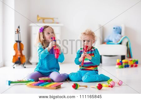 Boy And Girl Playing Flute