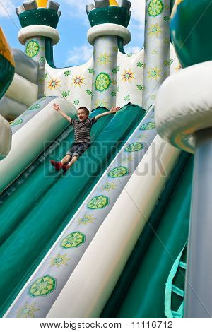 Boy In Inflatable Castle