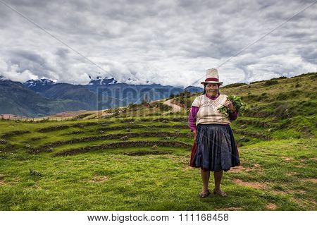 Peruvian woman in the Moray Inca Terraces, Peru