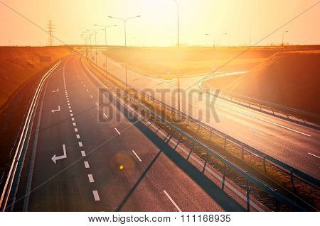 Red Sunset Over Empty Highway