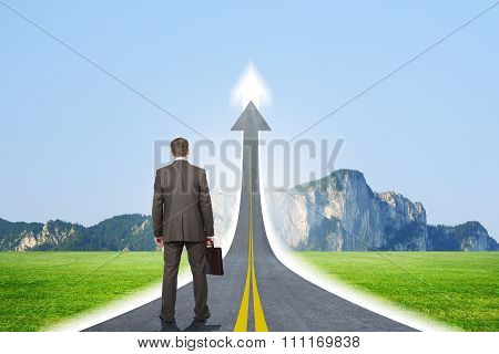 Person standing on roadway going up as arrow