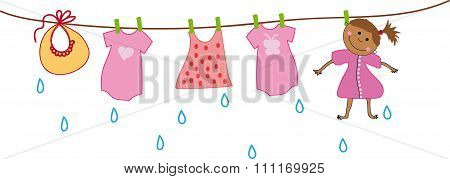 Girl dries on the clothesline with baby clothes