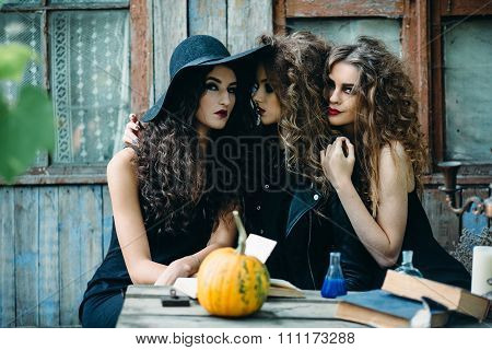 three vintage witch sitting at the table