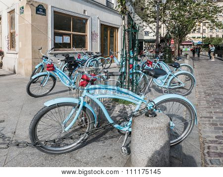 Blue Bike Tours Bicycles Parked Outside Bookstore In Paris