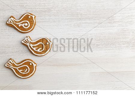 Gingerbread Cookies On White Wooden Table.