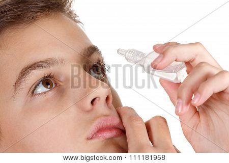 Boy Applying Eye Drop