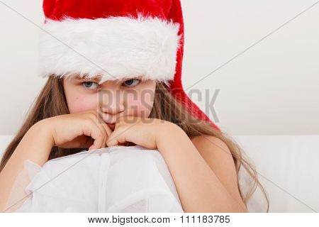 Bored Little Girl Kid In Santa Hat. Christmas.