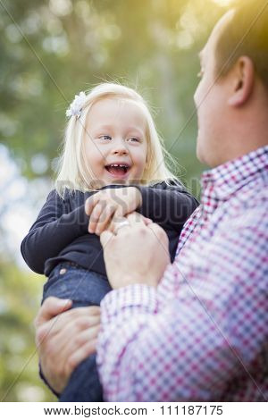 Adorable Little Baby Girl Having Fun With Daddy Outdoors.