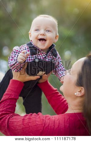 Cute Little Baby Boy Having Fun With Mommy Outdoors.