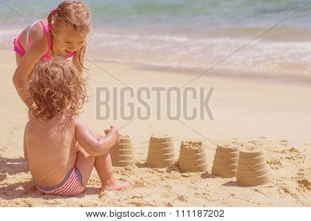 Little Girls Playing On The Beach