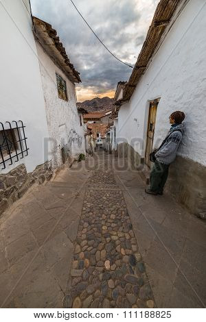 Tourist At Sunset In A Narrow Alley Of Cusco, Peru