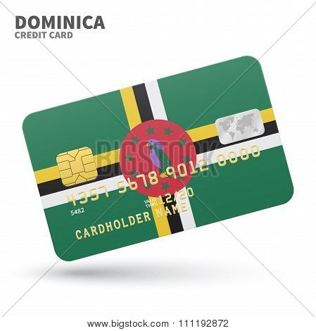 Credit card with Dominica flag background for bank, presentations and business. Isolated on white