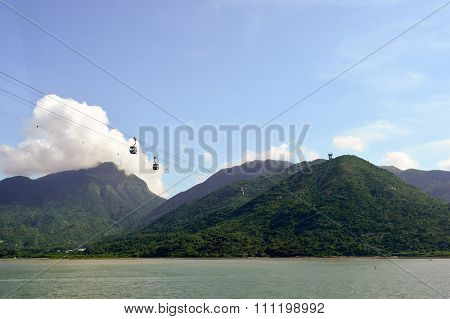 HONG KONG - JUNE 04, 2015: Ngong Ping 360 across Tung Chung Bay. The Ngong Ping 360 is a tourism project on Lantau Island in Hong Kong