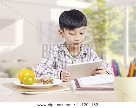 Asian Child Using Tablet Computer