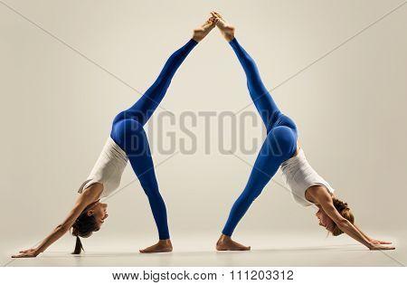 yoga in pair. Balance. splits. leg high