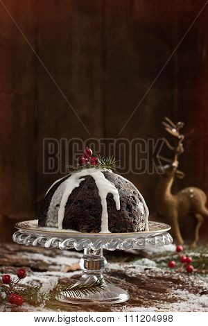 Christmas pudding and poured cream with creative lighting