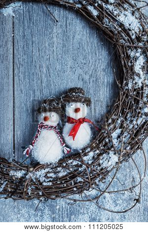 Close up of winter garland with snowmen decoration