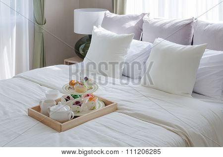 Wooden Ray Of Tea Set And Cup Cake On White Bed
