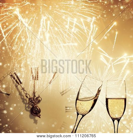 Holiday background with champagne glasses and clock closed to midnight
