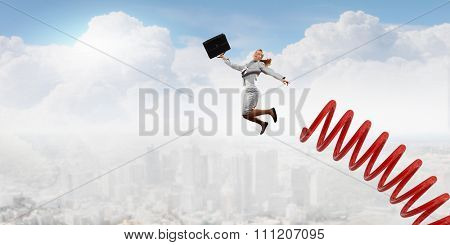 Businesswoman jumping on springboard as progress concept