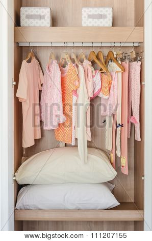 Kid's Wooden Wardrobe With Clothes Hanging