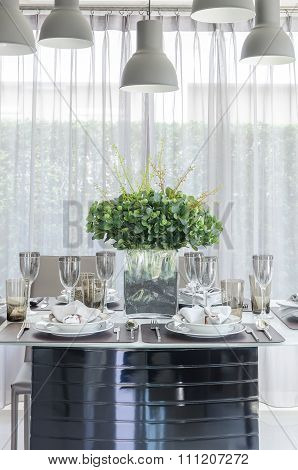 Table Set With Glass Vase Of Flower