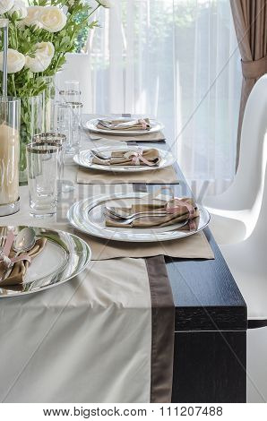Table Set On Dark Brown Wooden Table