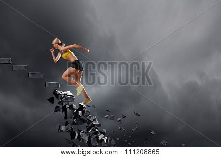Sports active woman running on stone collapsing ladder