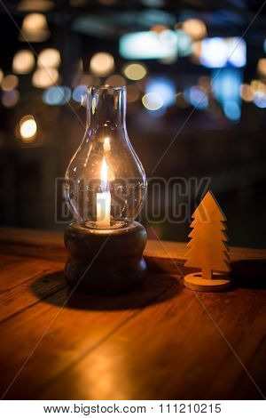 Candle And Chirstmas Plate With Bokeh Background