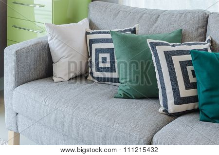 Modern Grey Sofa With Black And White And Green Pillows