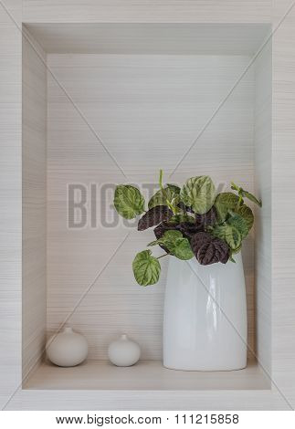 Artificial Plant In White Ceramic Vase