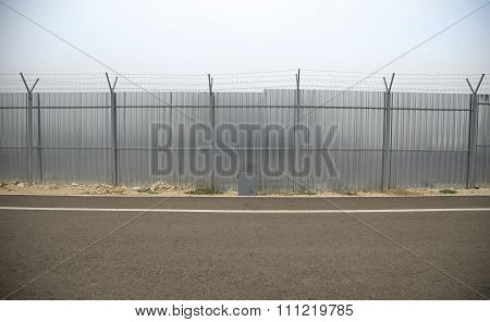 Construction fence along road