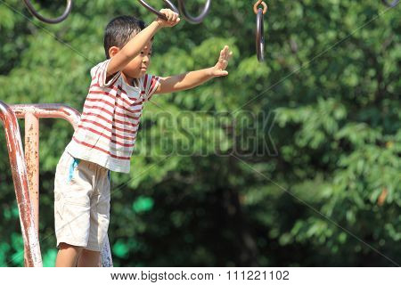 Japanese boy playing at field athletic (4 years old)