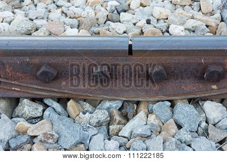 Old Rusted Screw On Railroad. Rusty Metal Rail Track Fixed On Stone
