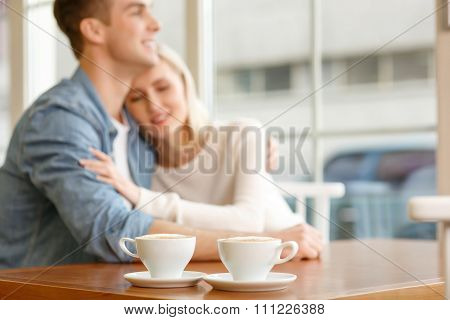 Loving couple sitting in the cafe